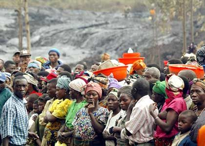 Congolese line up for a United Nations food delivery in 2002.