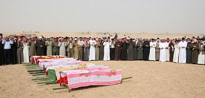 Villagers in Syria praying at a mass funeral for the victims of the American cross-border raid at the end of October.
