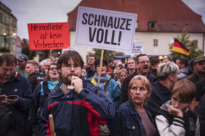 """""""Love of your homeland isn't a crime"""" and """"We've had enough!"""" An anti-Merkel protest in Finsterwalde in September."""