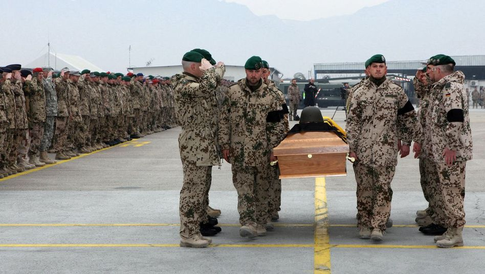 German soldiers took leave on Monday of those killed in Friday's attack.
