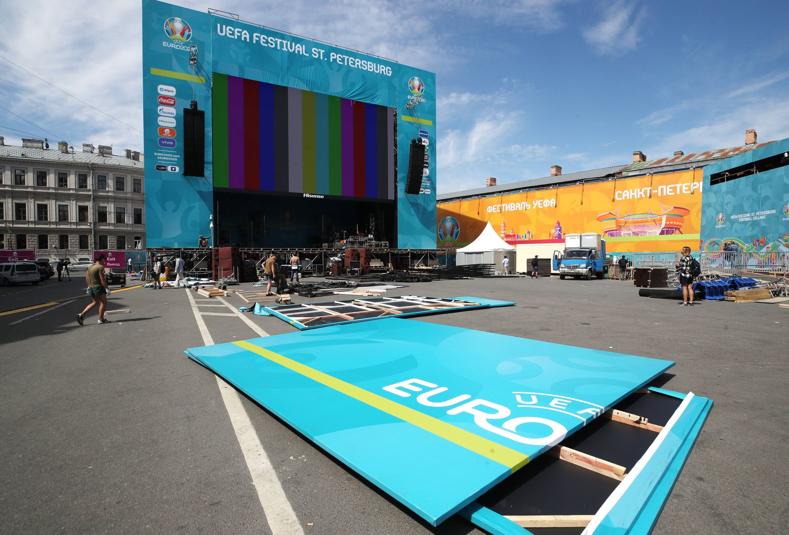 ST PETERSBURG, RUSSIA JUNE 9, 2021: Setting up a screen at the opening of a football village in Konyushennaya Square a