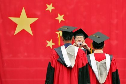 Students attending a graduation ceremony at China's Fudan University: Hopes for a successful career