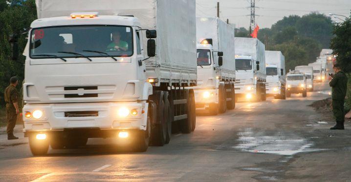 Völkerrechtler sind sich einig: Wollte Putin seine schmucken weißen Lastwagen nach Syrien schicken, bräuchte er dafür keine Erlaubnis