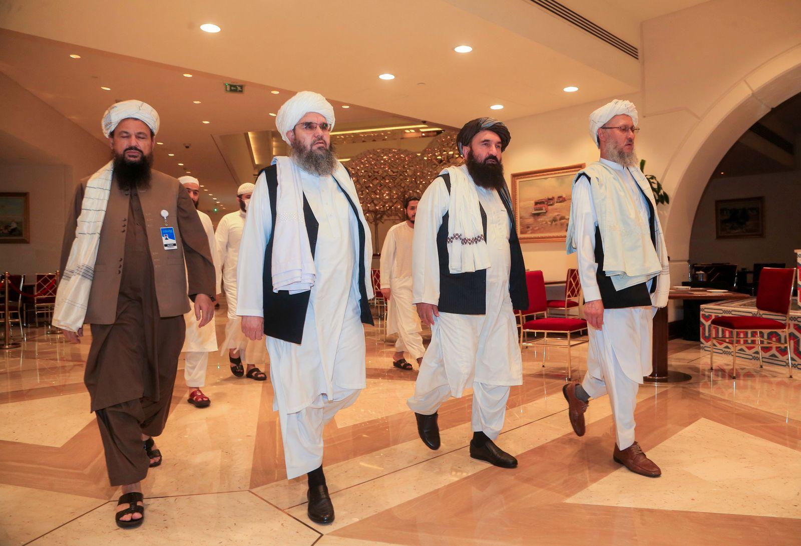 Abdul Salam Hanafi, member of the Taliban negotiating team and the Taliban delegation, arrive for Afghan peace talks in Doha