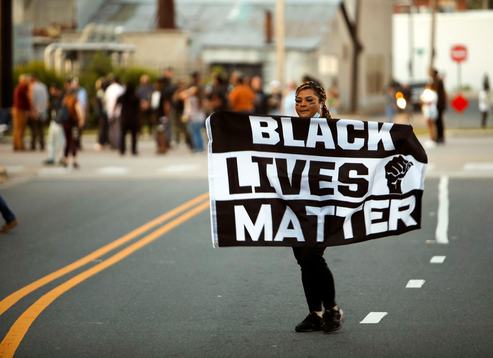 Protesters with BLM flag following the killing of a Black man by sheriffs in Elizabeth City