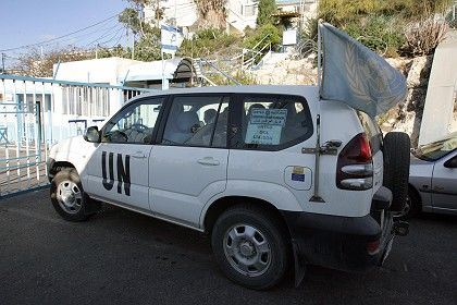 A United Nations vehicle waits to cross the northern Israeli border with Lebanon on Oct. 15 ahead of the exchange deal between Israel and Lebanon.