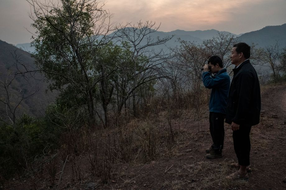 Early one morning, Gu Bojian (l.) and an acquaintance went birdwatching in the hills above the Red River.