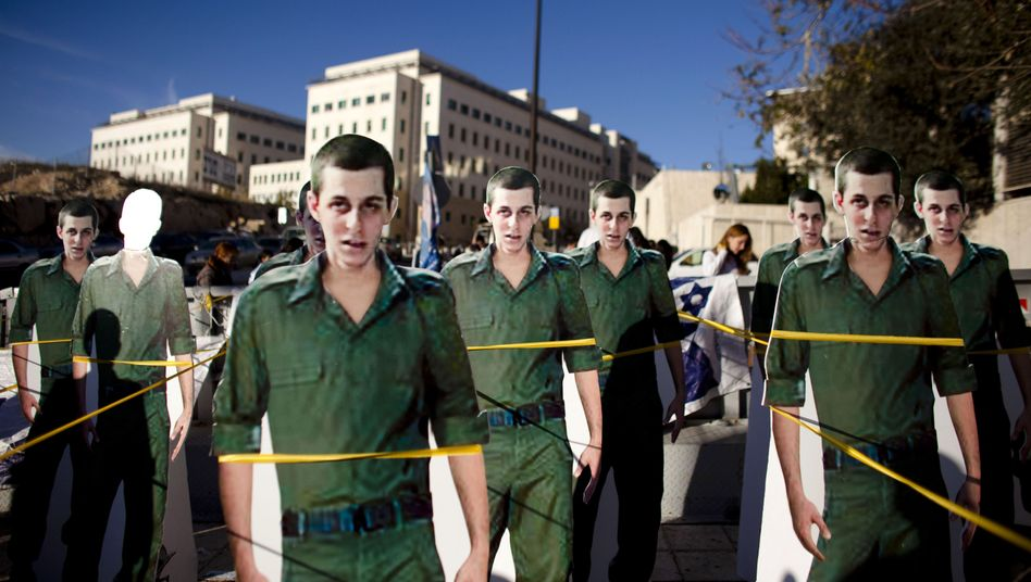 Cardboard cut-outs of abducted Israeli soldier Gilad Shalit are seen during a protest calling for Shalit's release outside Benjamin Netanyahu's office in Jerusalem: Negotiations between Hamas and Israel over a possible prisoner swap have now broken down.
