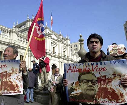 Allende has achieved almost legendary status in Chile. Here, marchers remember him on what would have been his 95th birthday in 2003.