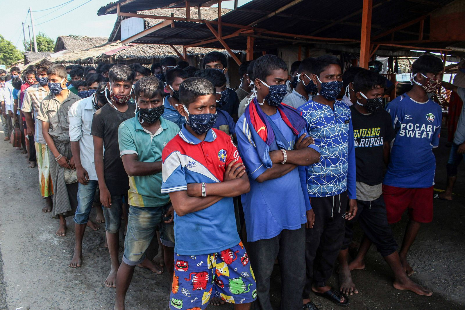 September 7, 2020, Lhokseumawe, Indonesia: Rohingya ethnic refugees wearing facemasks are seen being evacuated to a tem