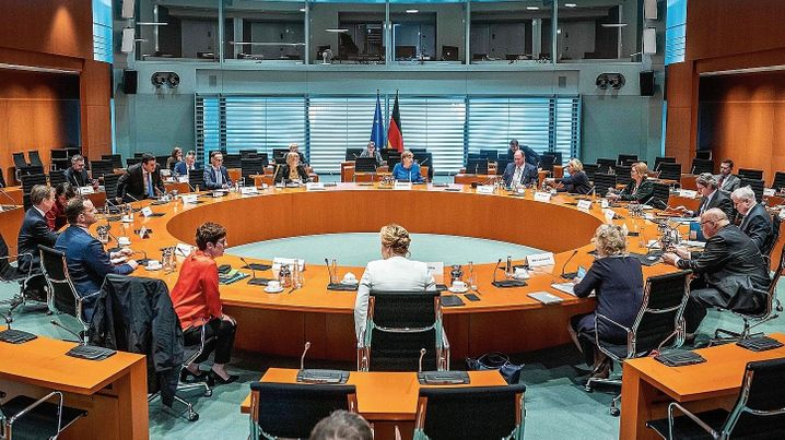 """A meeting of the German cabinet on March 18: """"We want to inform people in a very clear and transparent manner."""""""