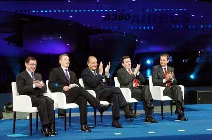 From the left: Airbus CEO Noel Forgeard, British Prime Minister Tony Blair, French President Jacques Chirac, German Chancellor Gerhard Schroeder, and Spanish Prime Minister Jose Luis Zapatero applaud during the unveiling ceremony of the Airbus A380 super jumbo.