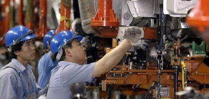 Arbeiter in chinesischem VW-Werk: Viele deutsche Standorte im Land