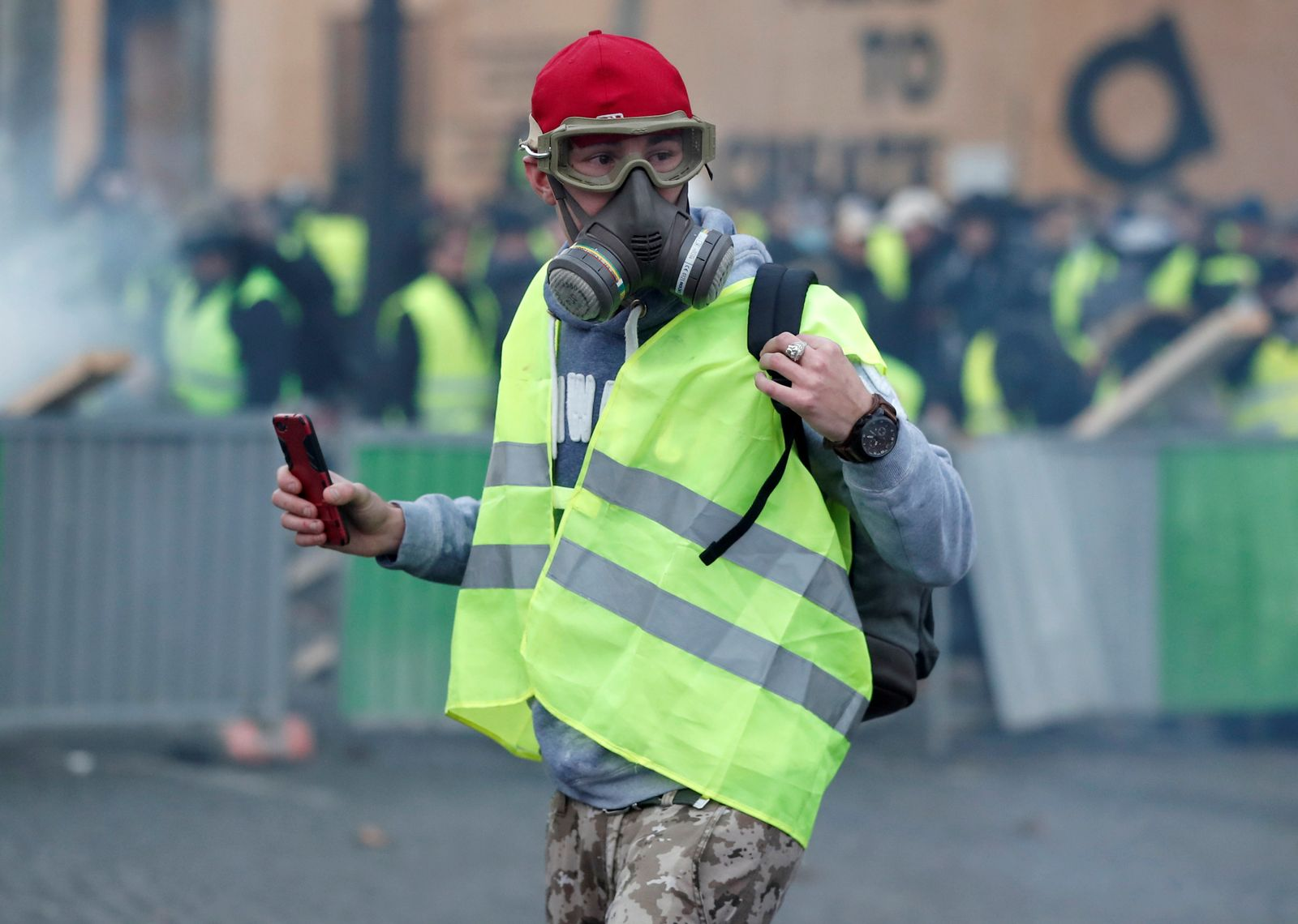 A protester wearing yellow vest, a symbol of a French drivers' protest against higher fuel prices, demonstrates on the the Champs-Elysee in Paris