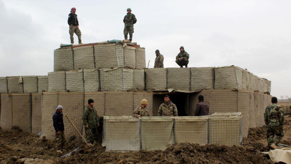 Afghanische Militärs in der Provinz Kundus (im März): Fast täglich kommt es im ganzen Land zu tödlichen Zwischenfällen