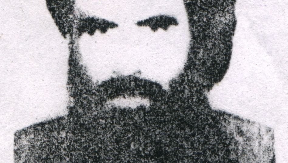 Afghan Taliban leader Mullah Omar, shown here in a dated photograph, has reportedly aurthorized a handful of people to engage in exploratory talks with Western forces.