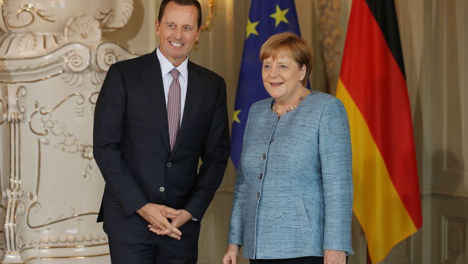 Richard Grenell und Angela Merkel