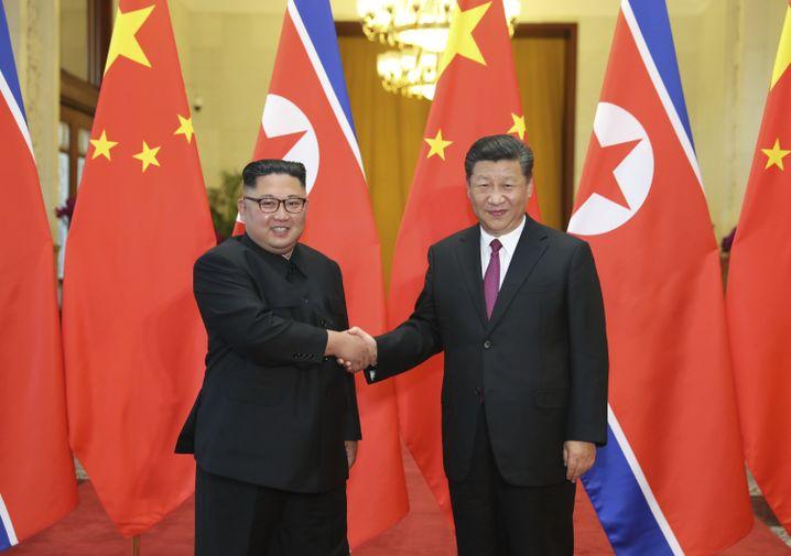Kim Jong Un und Xi Jinping in Peking