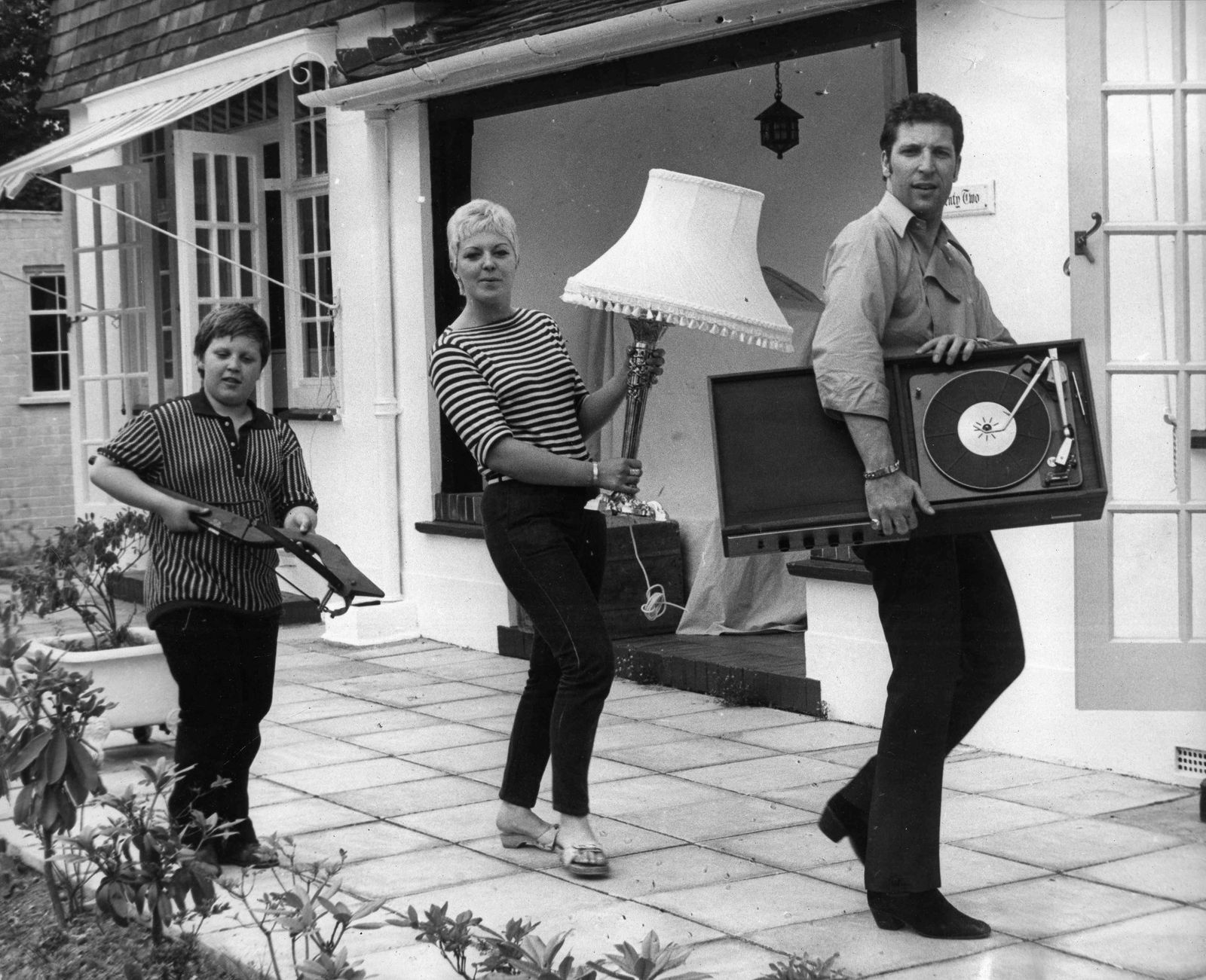 Date Unknown Surrey England U K Singer TOM JONES moves into his new home in Surrey with his w