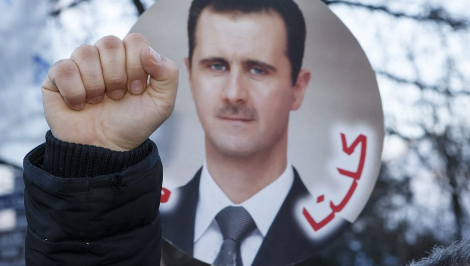 A sign with the face of Syrian President Bashar al-Assad at a protest in Geneva.