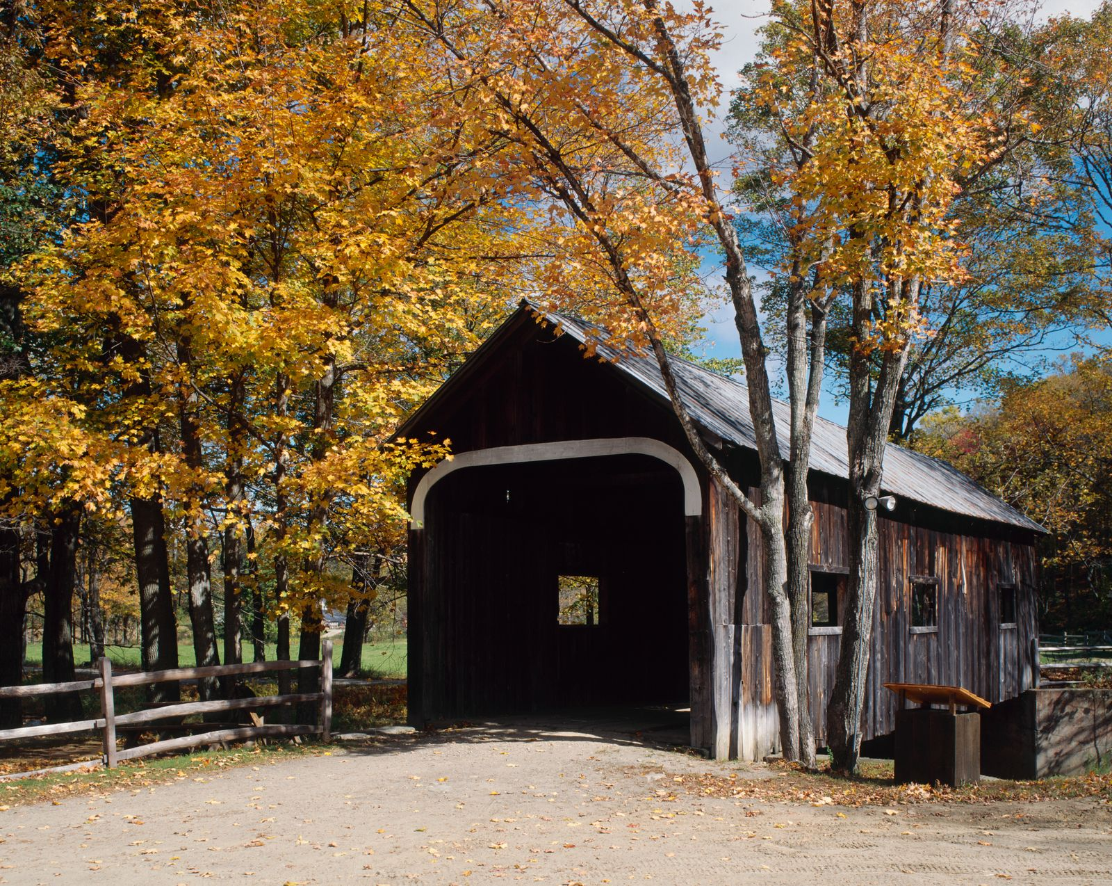 Car at opening of covered bridge,Grafton,Vermont,New England,USA
