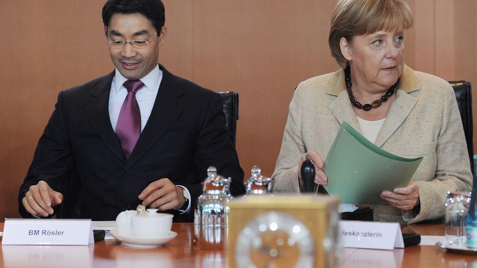 """FDP-Chef Rösler, Kanzlerin Merkel: """"Klima in der Koalition unnötig beeinträchtigt"""""""