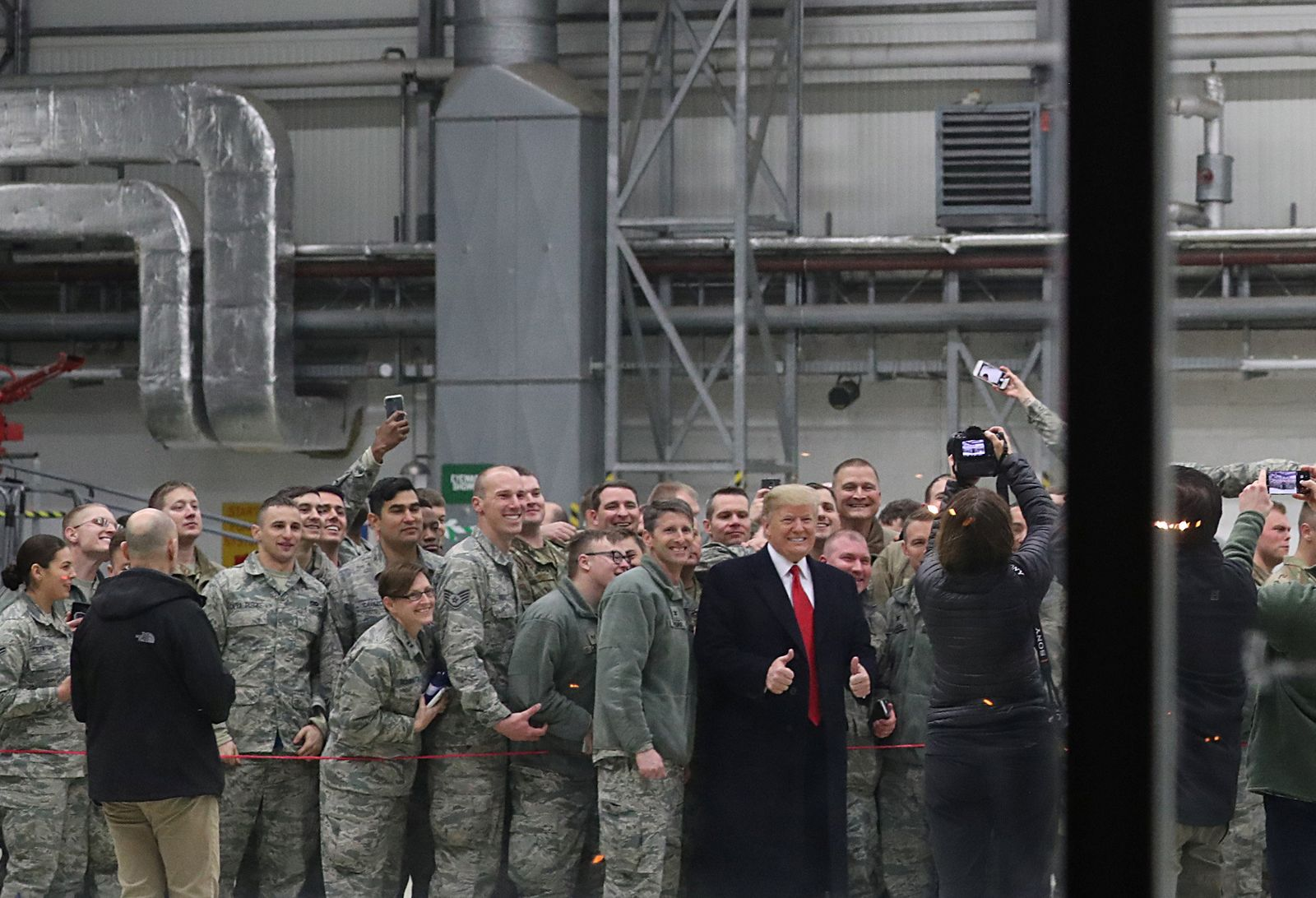 U.S. President Donald Trump takes a photo with U.S. troops at Ramstein Air Force Base in Germany