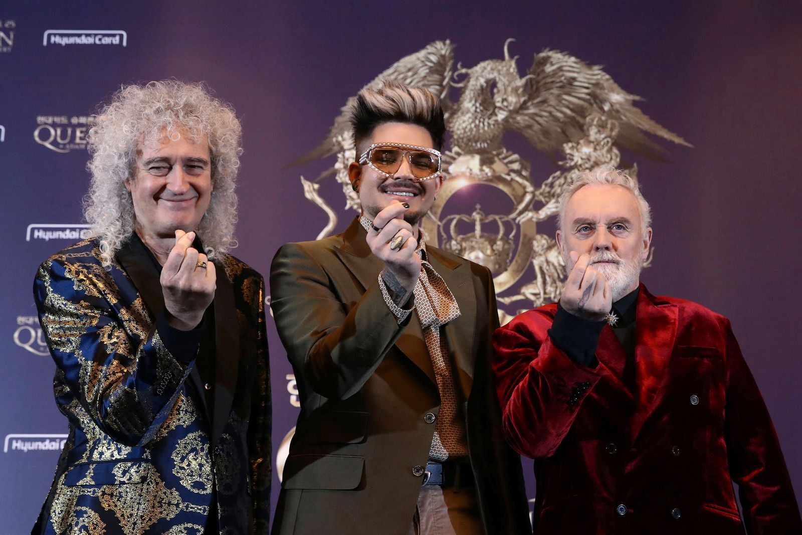 Brian May, Adam Lambert and Roger Taylor of Queen attend the news conference ahead of the Rhapsody Tour at Conrad Hotel in Seoul, South Korea