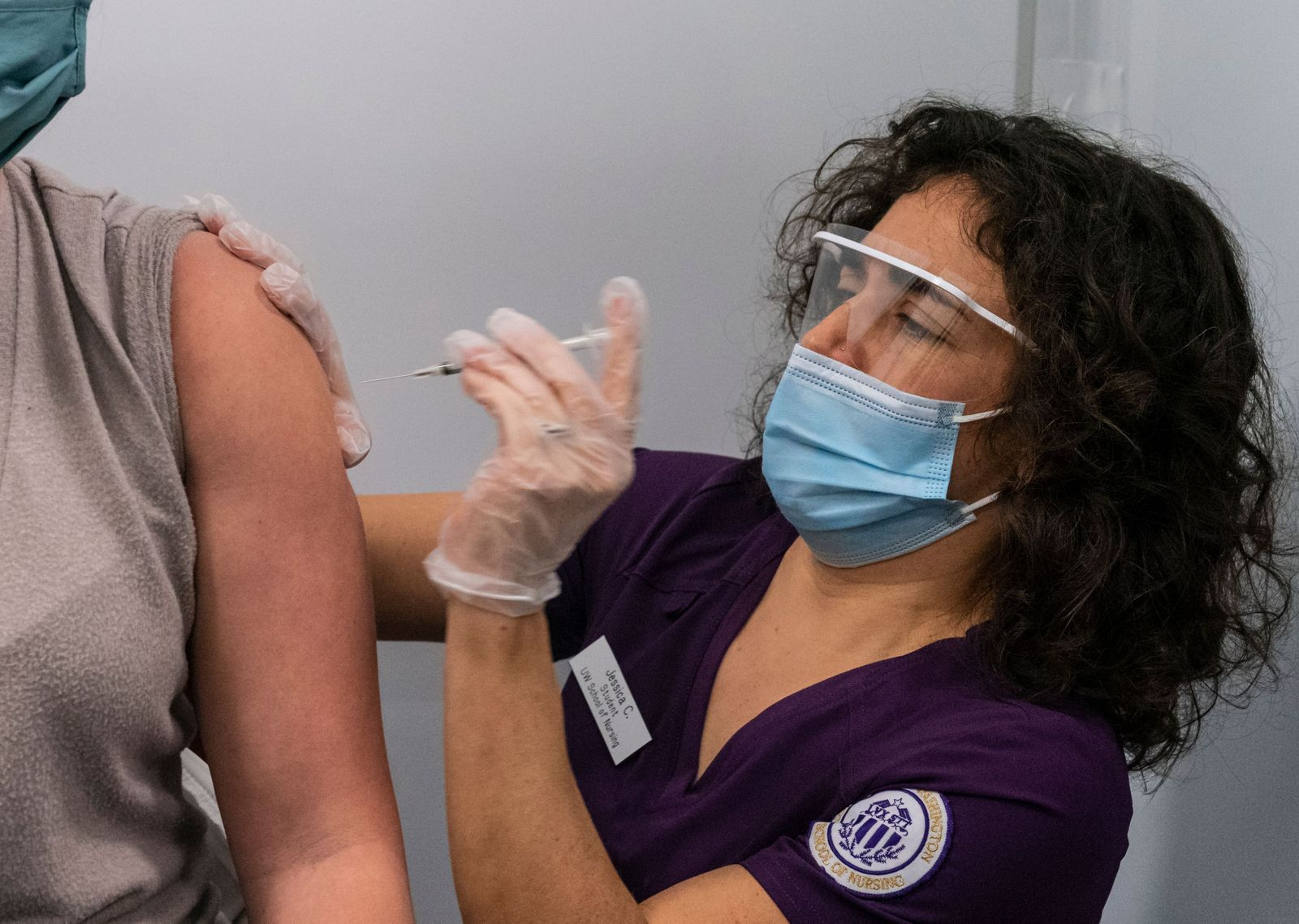 Frontline healthcare workers receive the Pfizer-BioNTech coronavirus vaccine, Seattle, USA - 18 Dec 2020