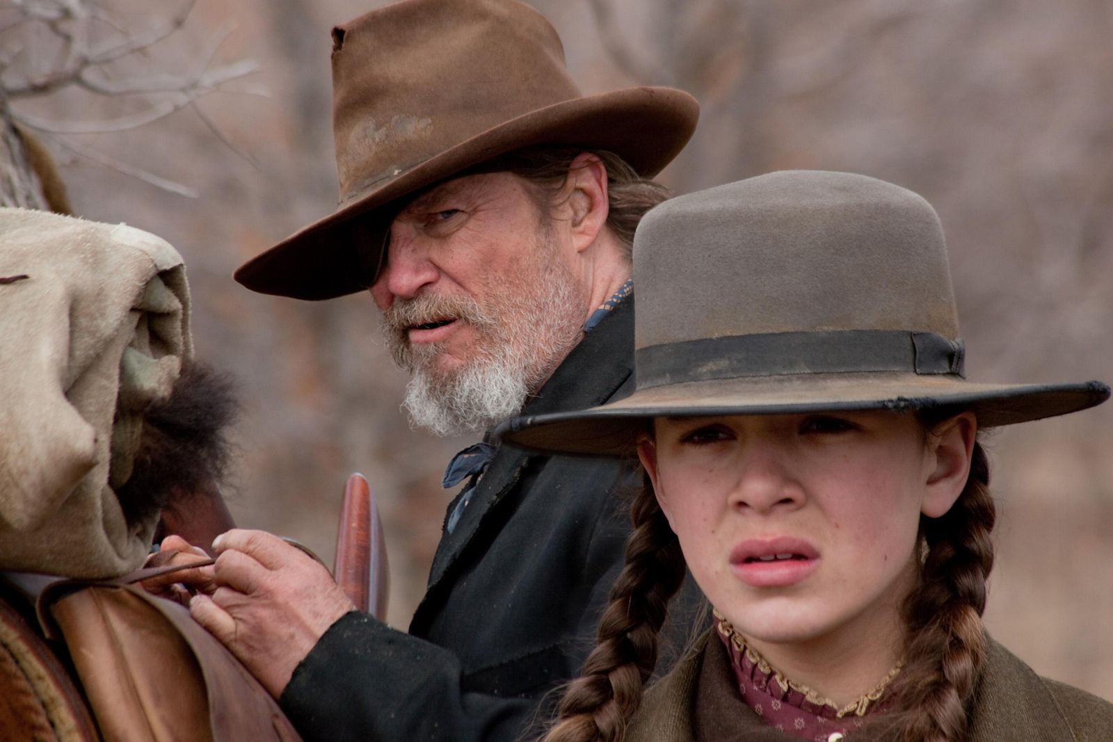 Film still shows actors Bridges and Steinfeld in scene from Berlinale competition film 'True Grit'