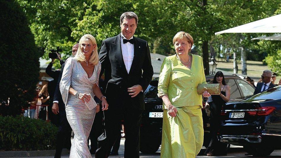Unionspolitiker Söder, Merkel (bei den Bayreuther Festspielen): Verführung zum Aktionismus