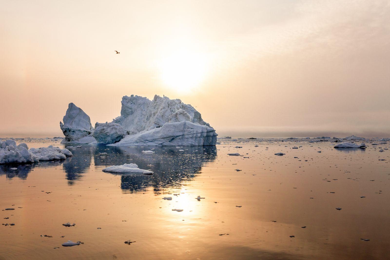 Iceberg in the sunset on beautiful sea