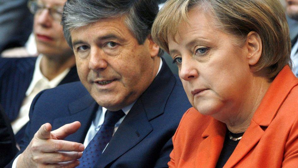 Bankchef Ackermann, Bundeskanzlerin Merkel: Gibt es einen sozialen Zusammenhalt?