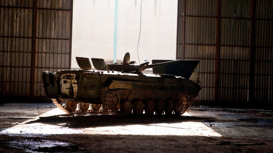 A burnt-out tank belonging to Gadhafi's security forces lies abandoned in a hangar near Al-Bayda on Sunday.