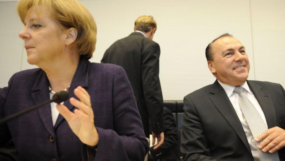 Kanzlerin Merkel, Bundesbank-Chef Weber: Beruft sie schon am Freitag einen Nachfolger?