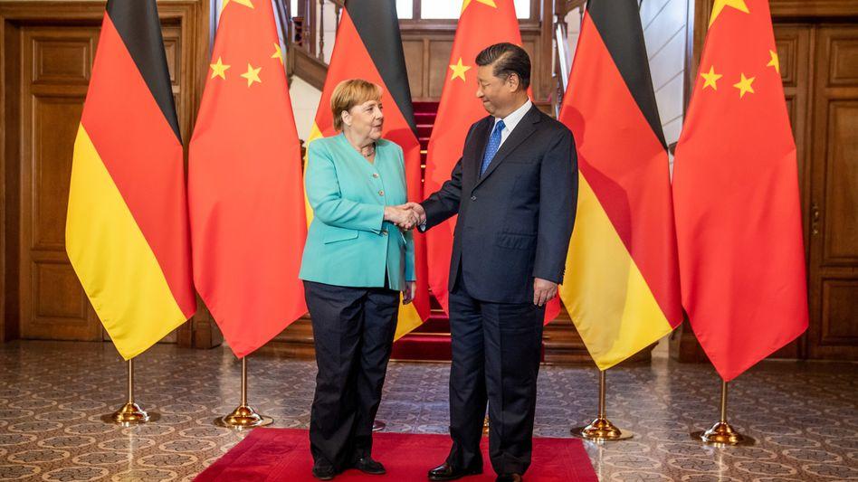 Kanzlerin Merkel, Chinas Präsident Xi Jinping (im September 2019): Friedliche Lösungen