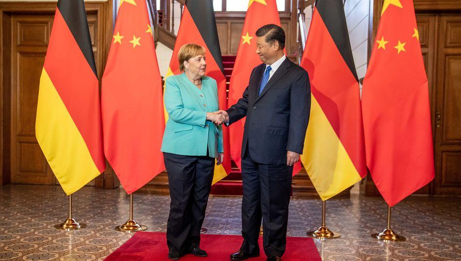 Kanzlerin Merkel, Chinas Präsident Xi Jinping: Cyberangriffe als verbindendes Thema