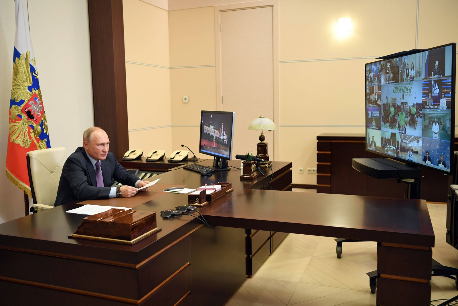 MOSCOW REGION, RUSSIA - DECEMBER 3, 2020: Russia s President Vladimir Putin holds a video conference meeting with repre