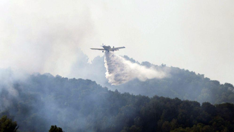 Waldbrände: Mit dem Gartenschlauch gegen die Flammen
