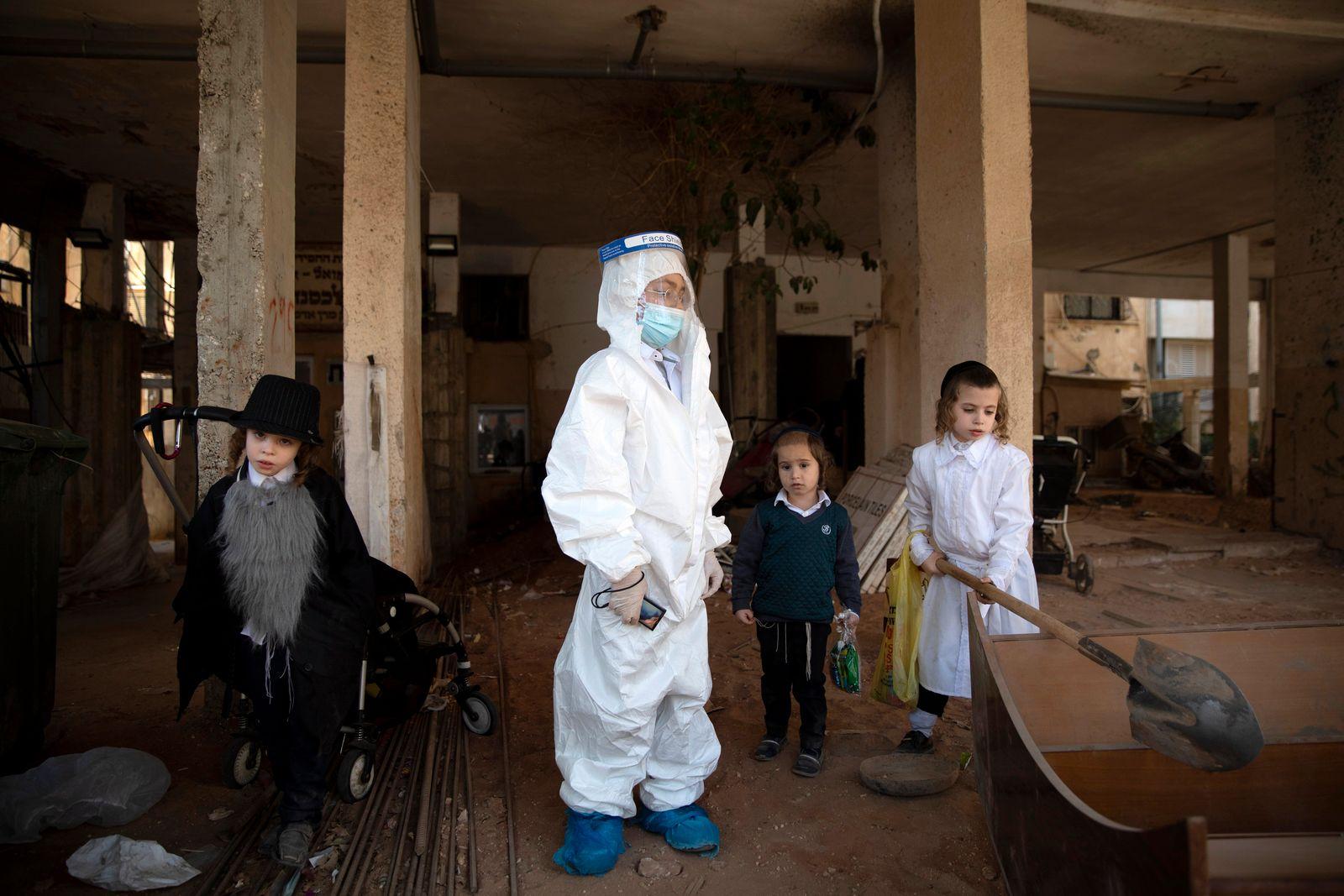APTOPIX Virus Outbreak Israel Purim