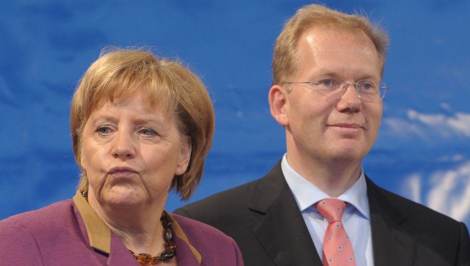 Kanzlerin Merkel, OB-Kandidat Turner (im Wahlkampf): CDU-Problem in den Städten