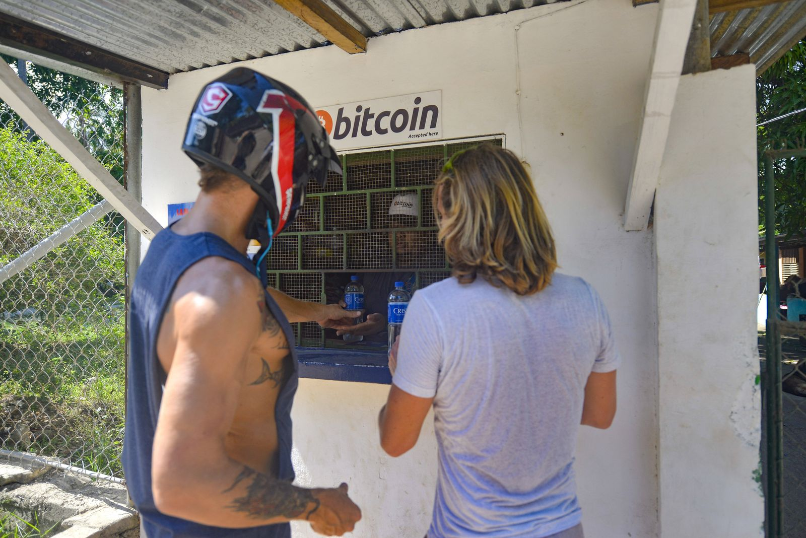 June 7, 2021, Chiltuipan, La Libertad, El Salvador: Tourists seen buying drinks at a store that accepts Bitcoin as a pay