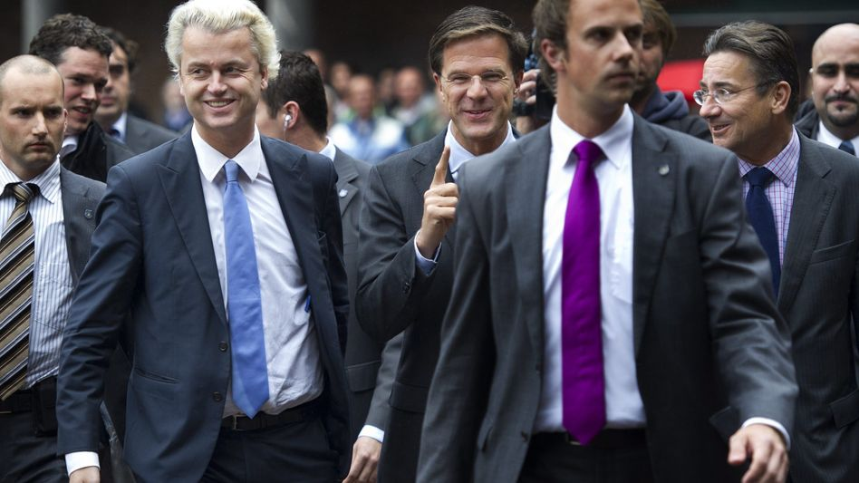 Dutch political leaders Geert Wilders (third from left) of the Freedom Party (PVV), Mark Rutte (center) of the Liberal Party (VVD) Maxime Verhagen (second from right) of the conservative Christian Democrats (CDA) are nearly finished with negotiations.
