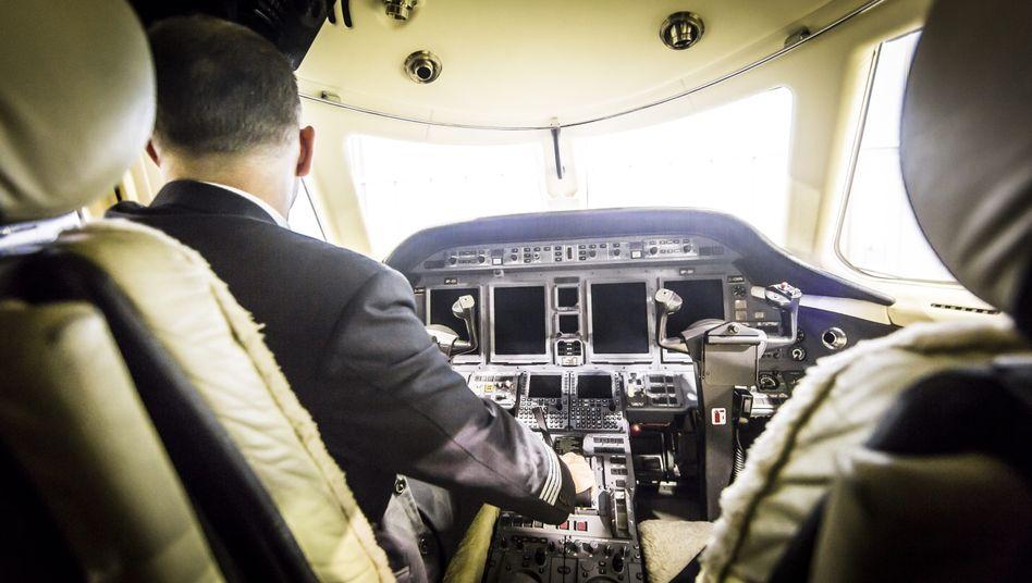 Karl Lückert* in his cockpit.