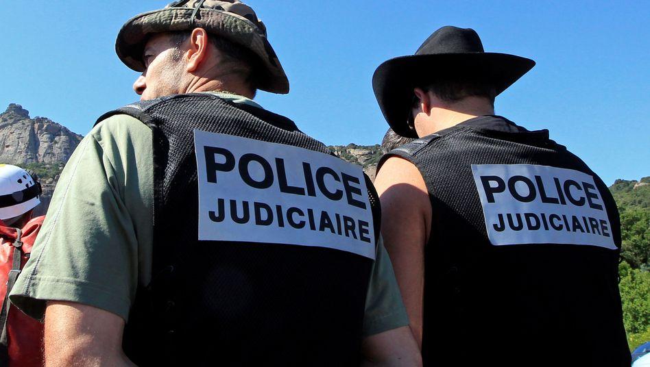 Französische Polizisten bei der Suche nach dem Mordverdächtigen (Archivbild von 2011)