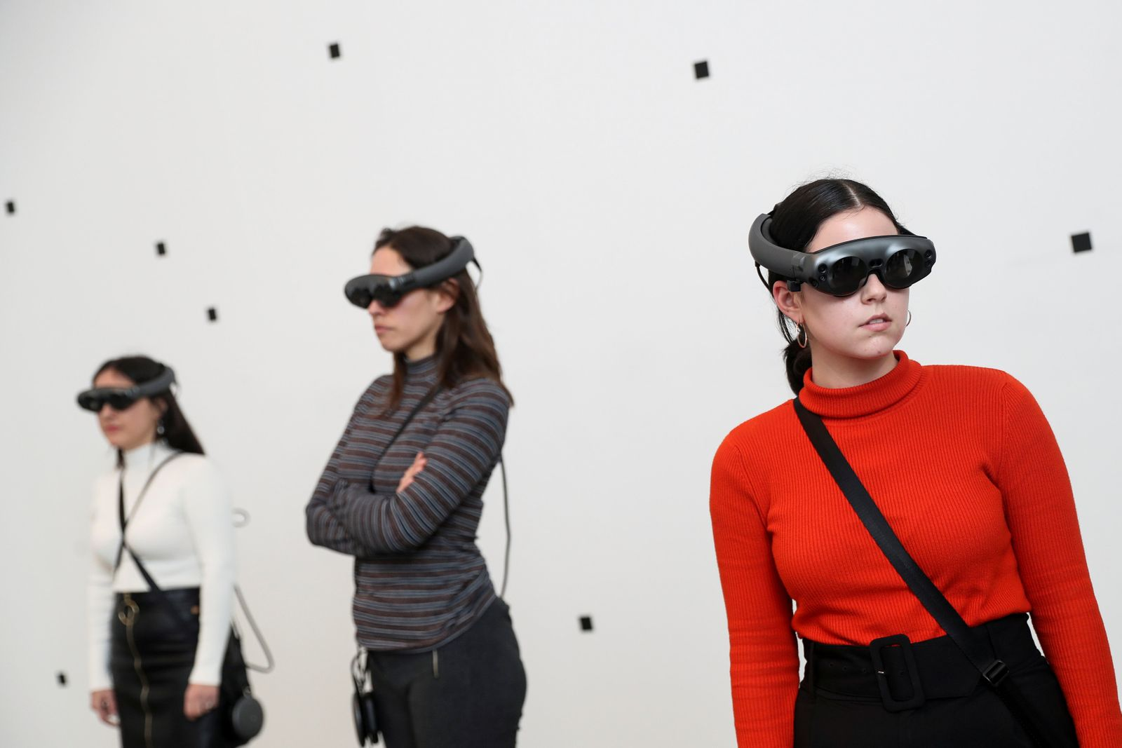 Attendees look through augmented reality glasses at Marina Abramovic's exhibition 'The Life', the world's first large-scale performance exhibited using Mixed Reality at the Serpentine Gallery in London