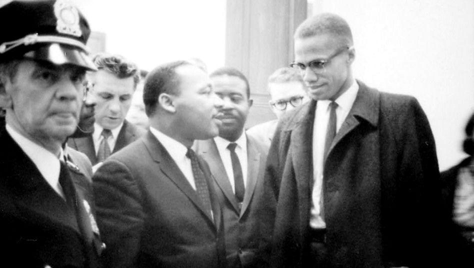 Malcom X (r.) und Martin Luther King Jr. (im Jahr 1964)