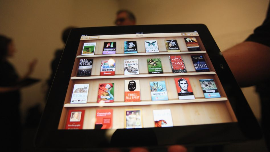 Bücher auf dem iPad (Symbolbild): Sammelklage wegen illegaler Preisabsprachen