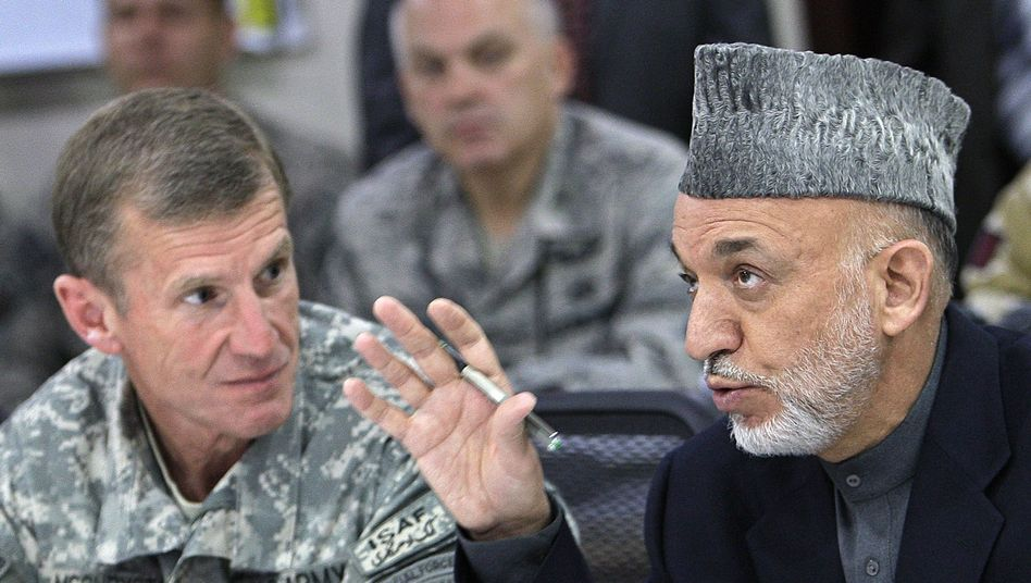 Afghan President Hamid Karzai, right, talks with US and NATO commander Gen. Stanley McChrystal at ISAF headquarters in Kabul