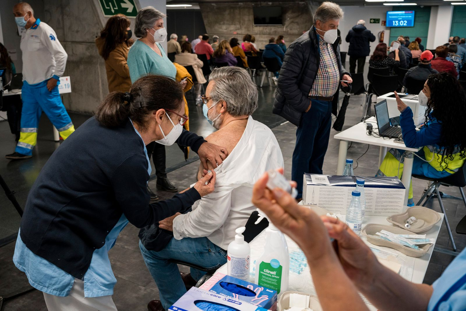 Nurses attend to people in the vaccination center of Wizink